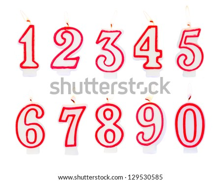 Burning birthday candles numbers isolated on white background