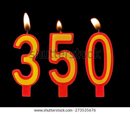 Burning birthday candles on black, number 350 - stock photo