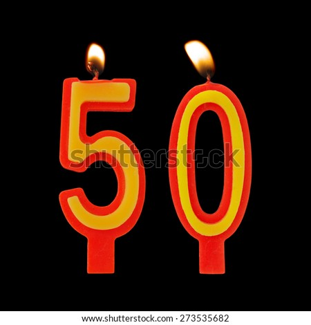 Burning birthday candles on black, number 50 - stock photo