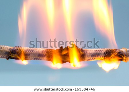 burning cable - stock photo