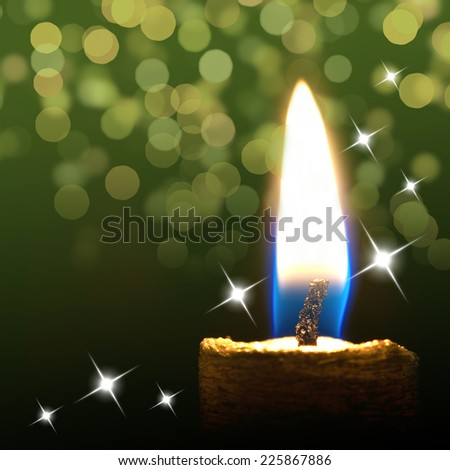 Burning candle on abstract color background  - stock photo