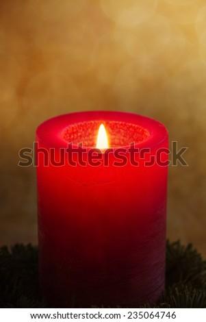 Burning candle with grunge background - stock photo