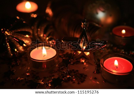 Burning candles and New Year's ornaments