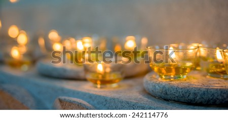 Burning candles at a Buddhist temple asian china - stock photo