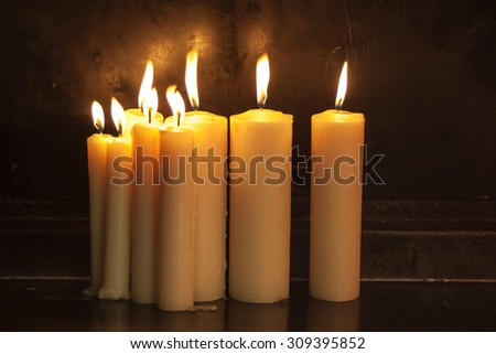 Burning candles at night - stock photo