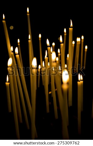 Burning candles in a church - stock photo