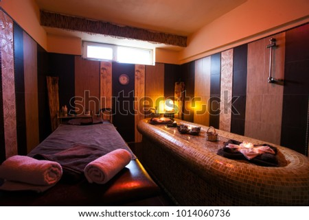 burning candles in spa wellness and massage room in hotel