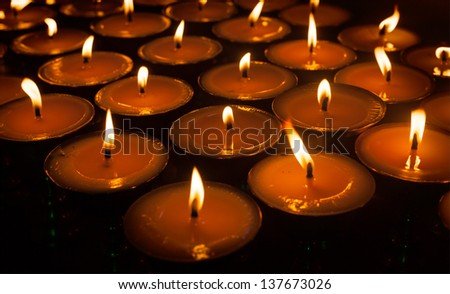 Burning candles in Tibetan Buddhist temple. Himachal Pradesh, India - stock photo