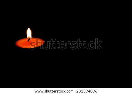 Burning candles on a dark background with warm light