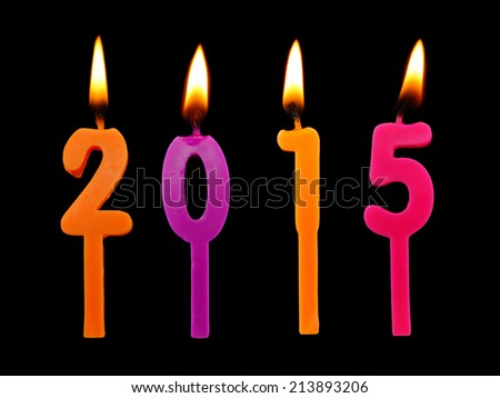 Burning candles on black background, number 2015, new year concept  - stock photo