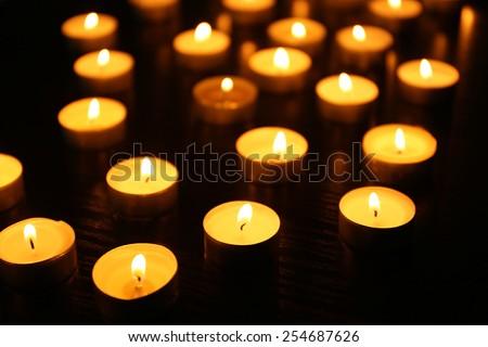 Burning candles on dark background - stock photo
