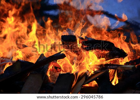 Burning charcoal and fire flames background.