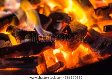 burning charcoal close up in the background - stock photo