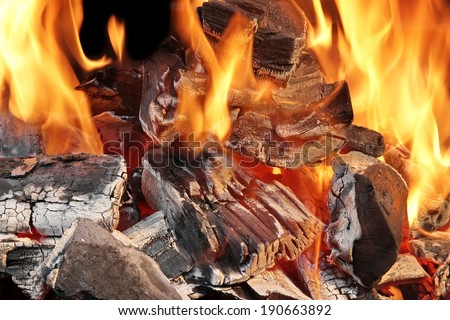 Burning Charcoal in BBQ Close-up,  with space for text or image. - stock photo