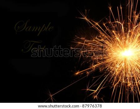 Burning Christmas sparkler isolated on black background. Bengal fire. - stock photo