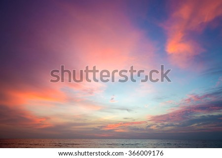 Burning clouds and tropical sea after the sun is set - stock photo