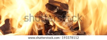 Burning Coals close-up. Background with space for text or image. - stock photo