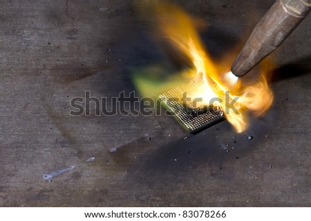 burning cpu with blow pipe. - stock photo
