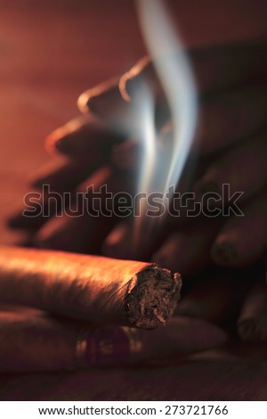 Burning Cuban cigar / burning cigarette