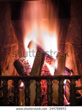 Burning fire in the fireplace. Cosy place - stock photo