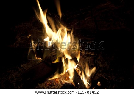 Burning fire indoor at an old village house - stock photo