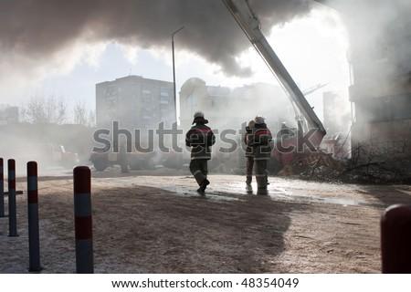 Burning fire smoke firefighter emergency service - stock photo
