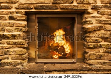 burning fireplace - stock photo