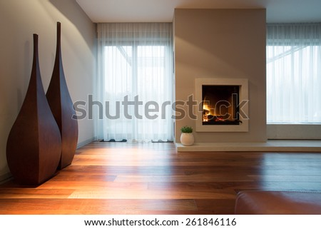 Burning fireplace and designed decoration in living room - stock photo