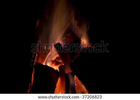burning fireplace used as a campfire