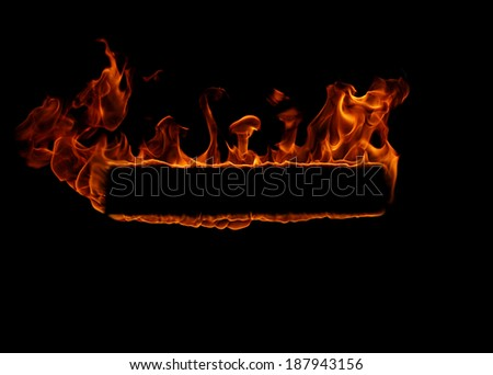 Burning flame isolated on black background with space for text - stock photo