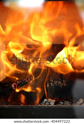 Burning flames in the fireplace close up - stock photo