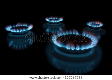 Burning gas in a circle on isolated on black. - stock photo