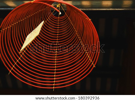 Burning hanging incense coils at Hoi Quan Quang Trieu temple. The Cantonese Assembly Hall founded in 1786 serves the Chinese community of Hoi An. - stock photo