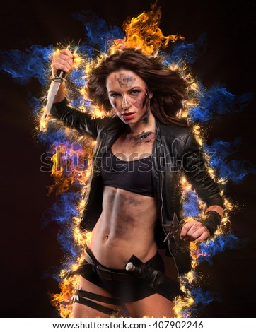 Burning hot and sexy woman with gun. Riot girl.   - stock photo