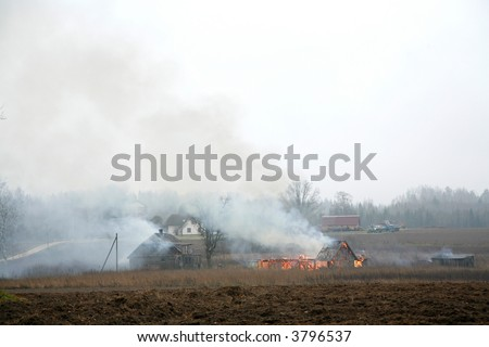 burning house in the countryside