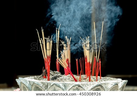 Burning incense burner in Chinese temple. - stock photo