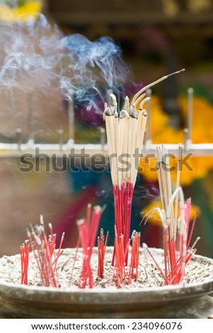burning incense joss sticks at a Chinese temple - stock photo