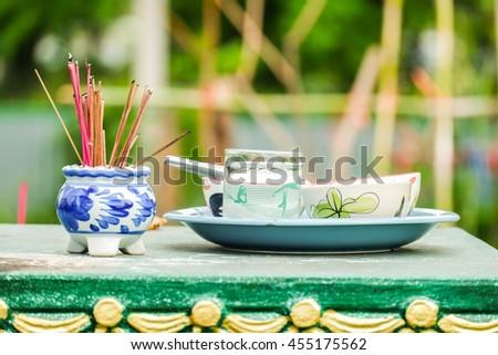 Burning Incense sticks and food set - stock photo