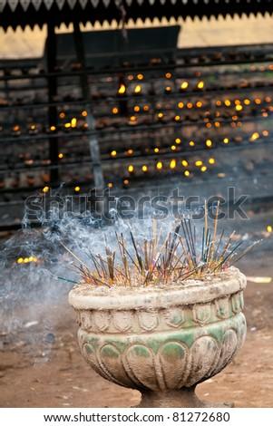 Burning incense sticks in a buddhist temple in Sri Lanka - stock photo