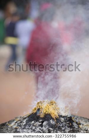 Burning incense sticks outside a temple in Kathmandu. nepal - stock photo