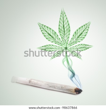 Burning joint with marijuana-shaped rising smoke. - stock photo