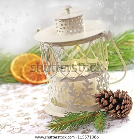 Burning lantern and christmas decorated - stock photo