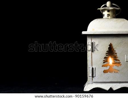 Burning lantern on the black background - stock photo