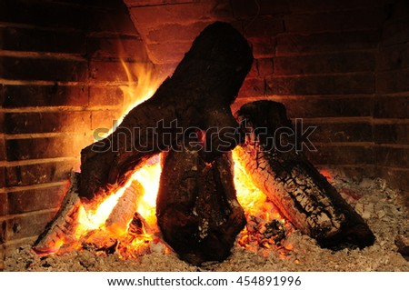 burning logs in fireplace - stock photo