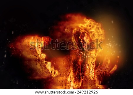 Burning Male Protesteron Fire  Shouts at Riot Act on the Streets. - stock photo