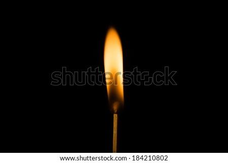 Burning Match / Single burning match with black background - stock photo