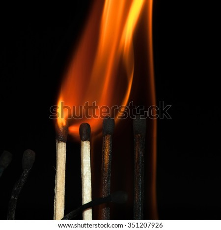 Burning matches on a black background. Bright fire. - stock photo