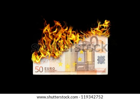 Burning money, euro bill on fire, isolated on black - stock photo
