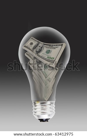 Burning money with old style light bulbs.