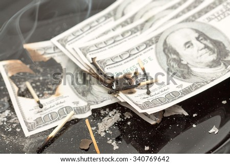 burning one hundred dollars bill